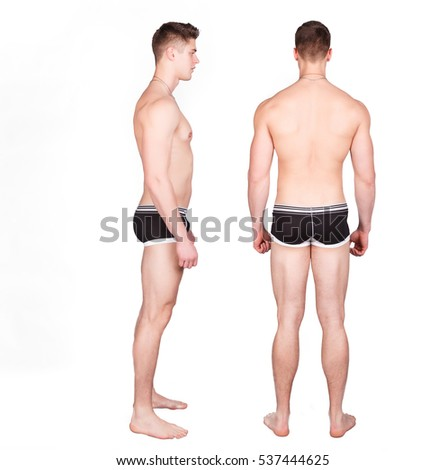 Man in underwear standing on a white background. He turned sideways to the camera and is turned back