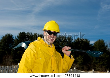 Man in uniform with a shovel close up - stock photo