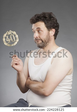 Man in vest looks skeptical, thoughtful 40 Years Birthday Decoration - stock photo