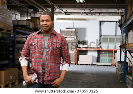 Man in warehouse - stock photo