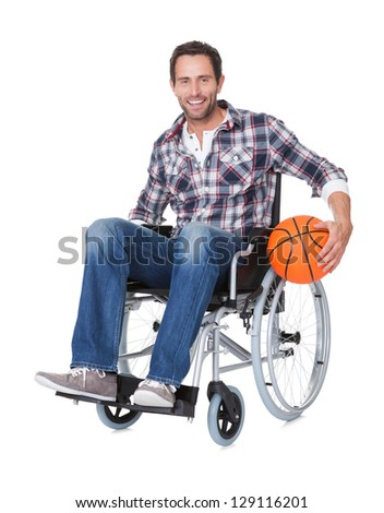 Man in wheelchair with basketball. Isolated on white - stock photo