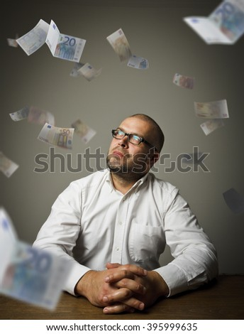Man in white and falling Euro banknotes. Currency and lottery concept. - stock photo