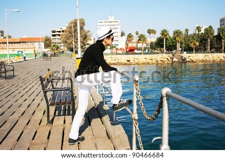 Man in white hat on the pier.