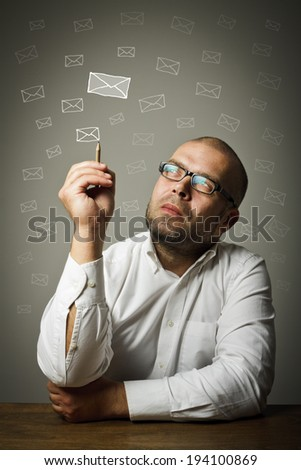 Man in white is ready to write something. Man in white looking at the letters. - stock photo