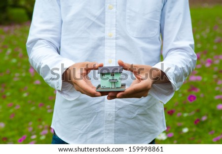Man in white shirt that has a model of my home