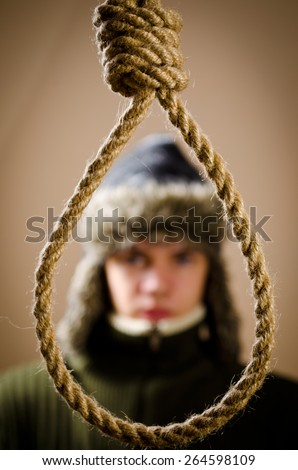 Man in winter cap with hanging noose - stock photo