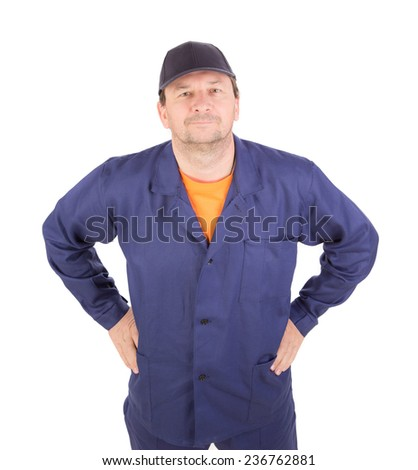 Man in working clothes with arms on waist. Isolated on a white background. - stock photo