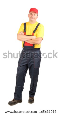 Man in working clothes with crossed arms. Close up