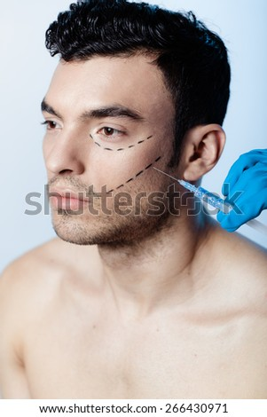 Man injected with Bot-ox anti-wrinkle - stock photo