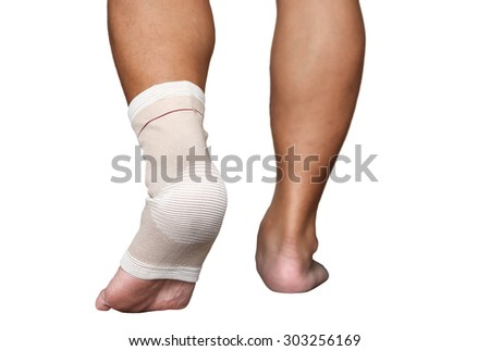 Man injured ankle and foot wrapped in bandage in white background - stock photo