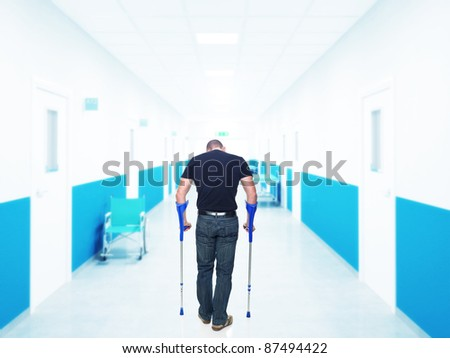 man injured in hospital back view - stock photo