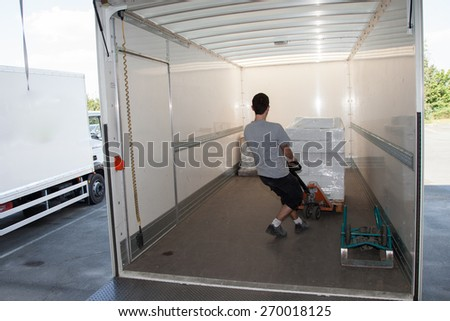 Man inside his truck handling - stock photo