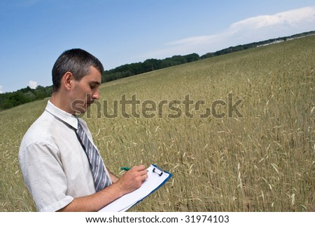 Man inspecting the wheat