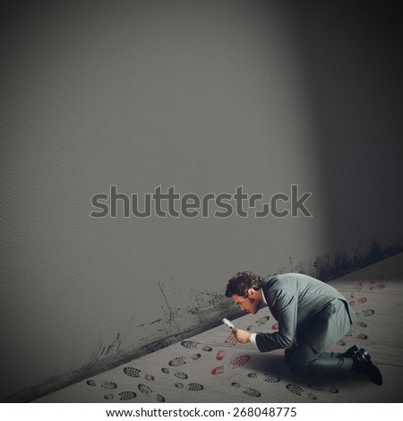 Man investigates the footsteps of the guilty - stock photo