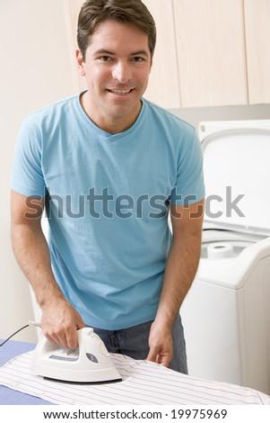 Man Ironing Shirt - stock photo