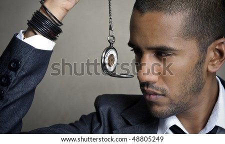 Man is aware of time and watches the hands tick by - stock photo
