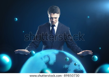Man is controlling the earth models. Young business man with planet system around him. Conceptual image of technology global communication - stock photo