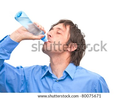 Man is drinking water from a plastic bottle, isolated on white background