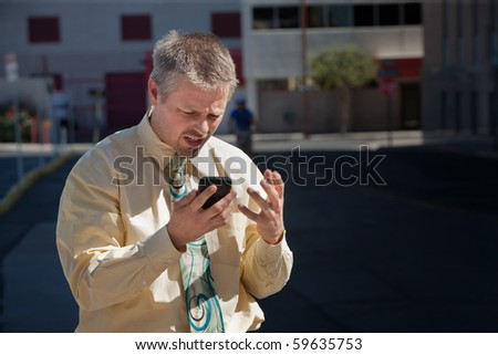 Man is frustrated with cell phone coverage. - stock photo