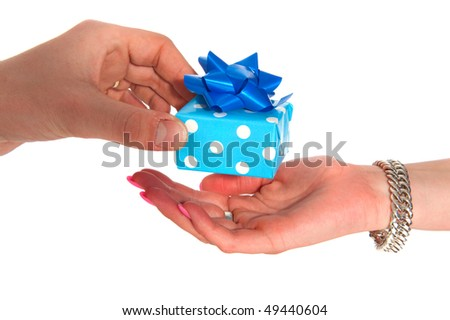 Man is giving a little present to a woman