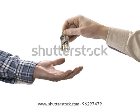 Man is handing a house key to a other man isolated
