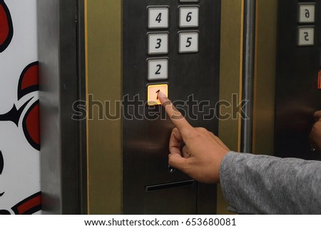 man is hitting the elevator