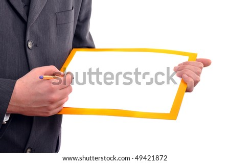 Man is holding a piece of blank white paper, business presentation scene