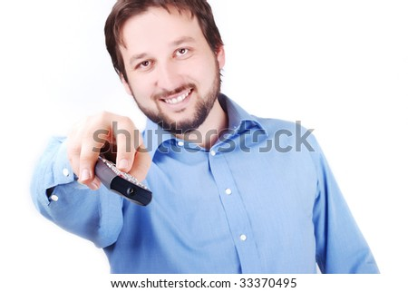 Man is holding remote control and looking in front of him - stock photo
