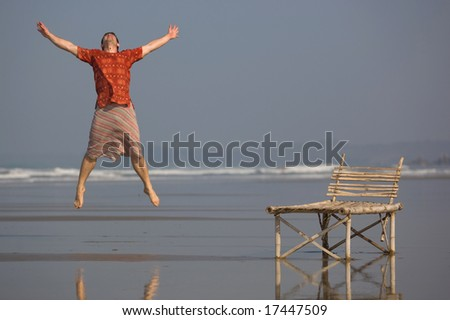 man is jumping with a smile - stock photo