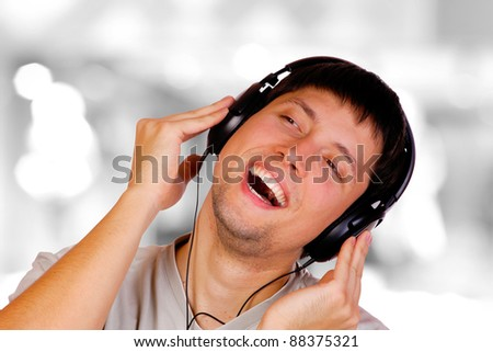 Man is listening to the music over bokeh background