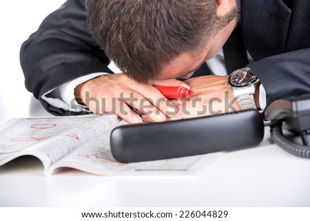 Man is looking a job. Bad news from newspaper - no work. Close-up. - stock photo