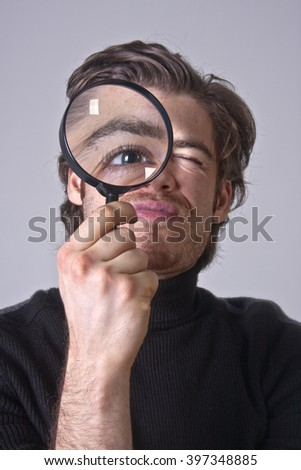 Man is Looking for something with magnifying glass