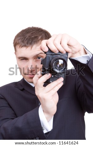 man is looking in old optical camera