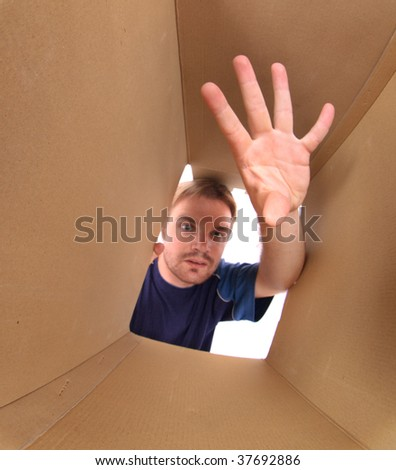 man is looking in the box - stock photo