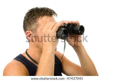 man is looking through spyglass over white background - stock photo