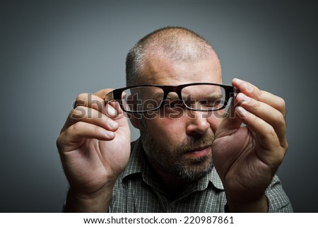 Man is looking through the glasses. - stock photo