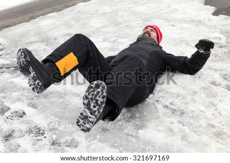 Man is lying on a icy way
