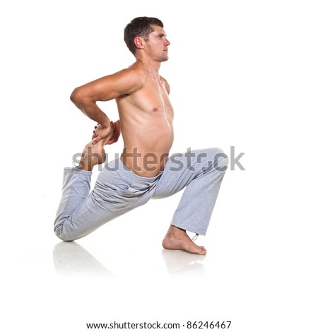 Man is making yoga isolated over white background - stock photo