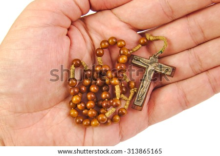 Man is offering rosary with his hand on white background - stock photo