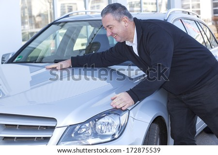 Man is pleased with his car - stock photo