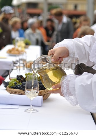 Man is pouring wine on celebration of grape harvest - stock photo