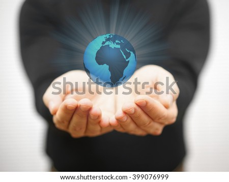 man is protecting the virtual earth with his hands, environment protection concept
