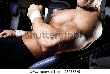Man is showing his biceps - stock photo