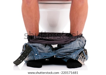 Man is sitting on the toilet bowl, on white background - stock photo