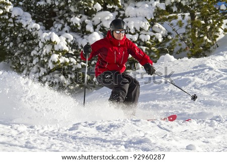 Man is skiing between trees