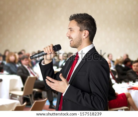 Man is speaking on indoor business conference for managers. - stock photo