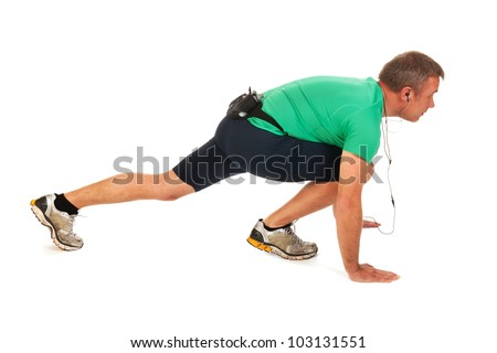Man is starting to run in the studio - stock photo