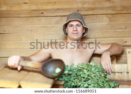 Man is taking a steam-bath  in sauna - stock photo