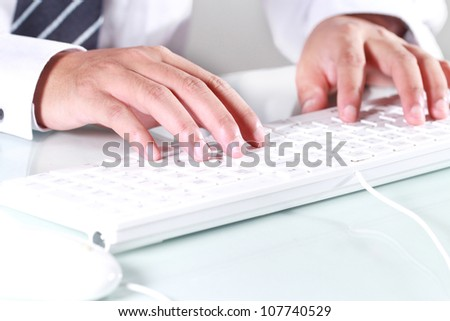 Man is typing computer keyboard - stock photo