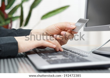 Man is using credit card and computer for  on line payment. internet shopping concept - stock photo